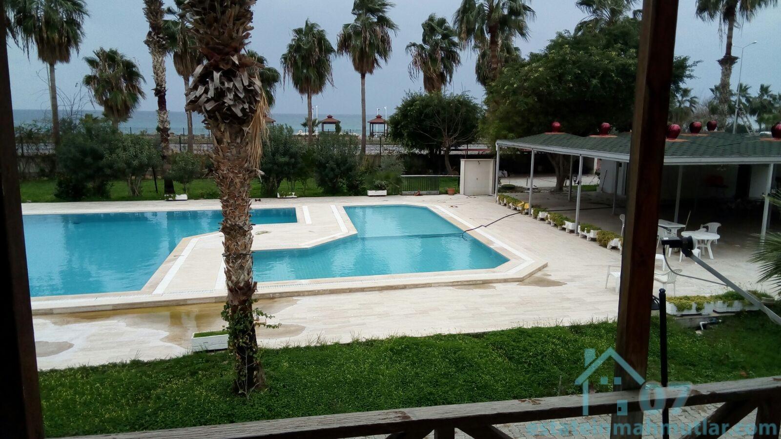 Three Bedroom Furnished Seaside Duplex Villa with a Sea and Pool View in Mahmutlar Alanya
